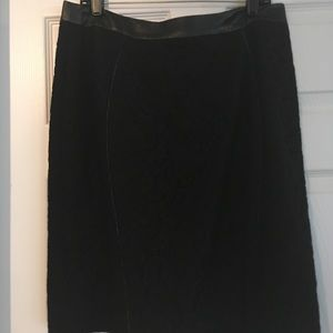 Lace skirt with faux leather waistband.